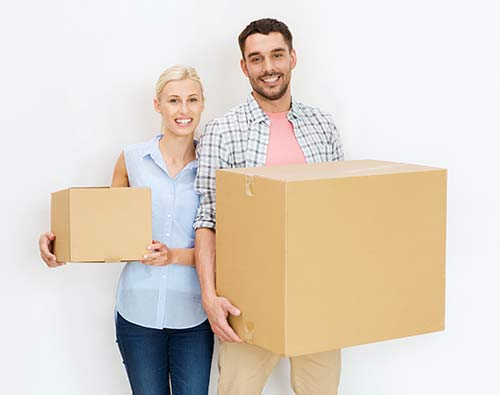 Couple holding boxes